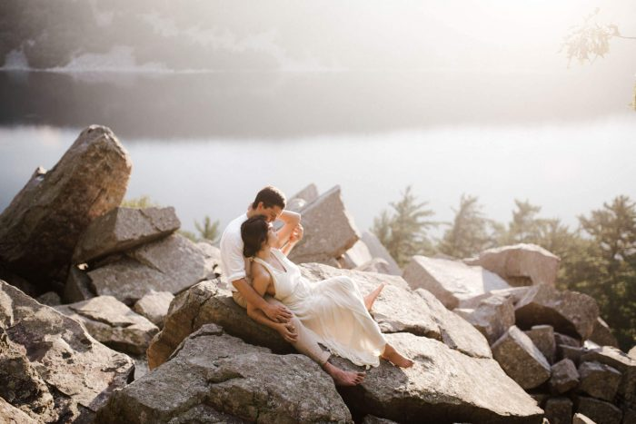 A bride and groom pose for beautiful wedding photos on Lake Michigan. Photographed by Michigan wedding photographer Farrah Julin.