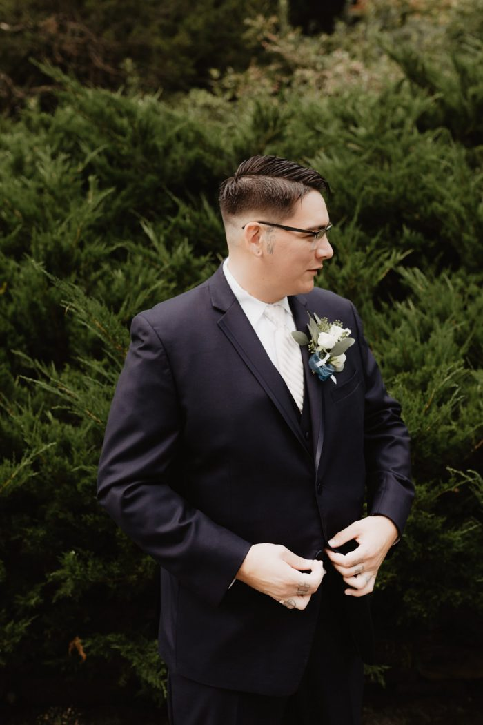 Photo of a groom getting ready for his backyard Wedding in Beacon, New York. Photographed by New York wedding photographer, Farrah Julin.