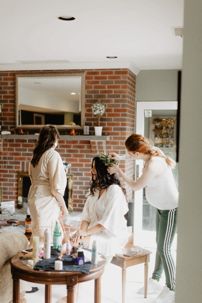 Photo of a bride getting ready for her backyard Wedding in Beacon, New York. Photographed by New York wedding photographer, Farrah Julin.