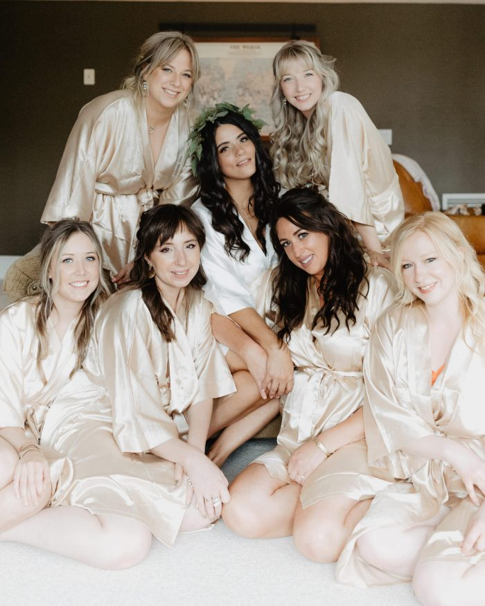Photo of a bride and her bridesmaids in robes while getting ready for her backyard Wedding in Beacon, New York. Photographed by New York wedding photographer, Farrah Julin.
