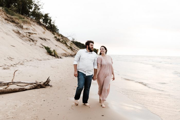 A bride and groom pose for their Lake Michigan Engagement photos. Photographed by Michigan Wedding Photographer, Farrah Julin.