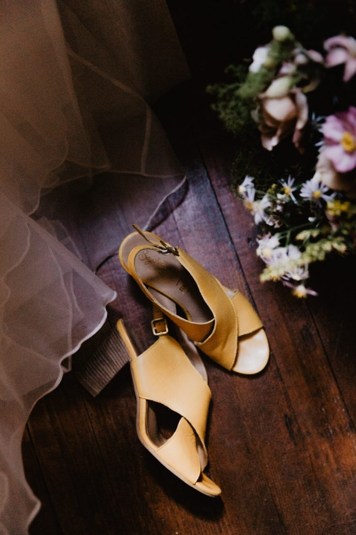 Yellow wedding shoes next to a bridal bouquet photo. Photographed by New York Wedding Photographer Farrah Julin.